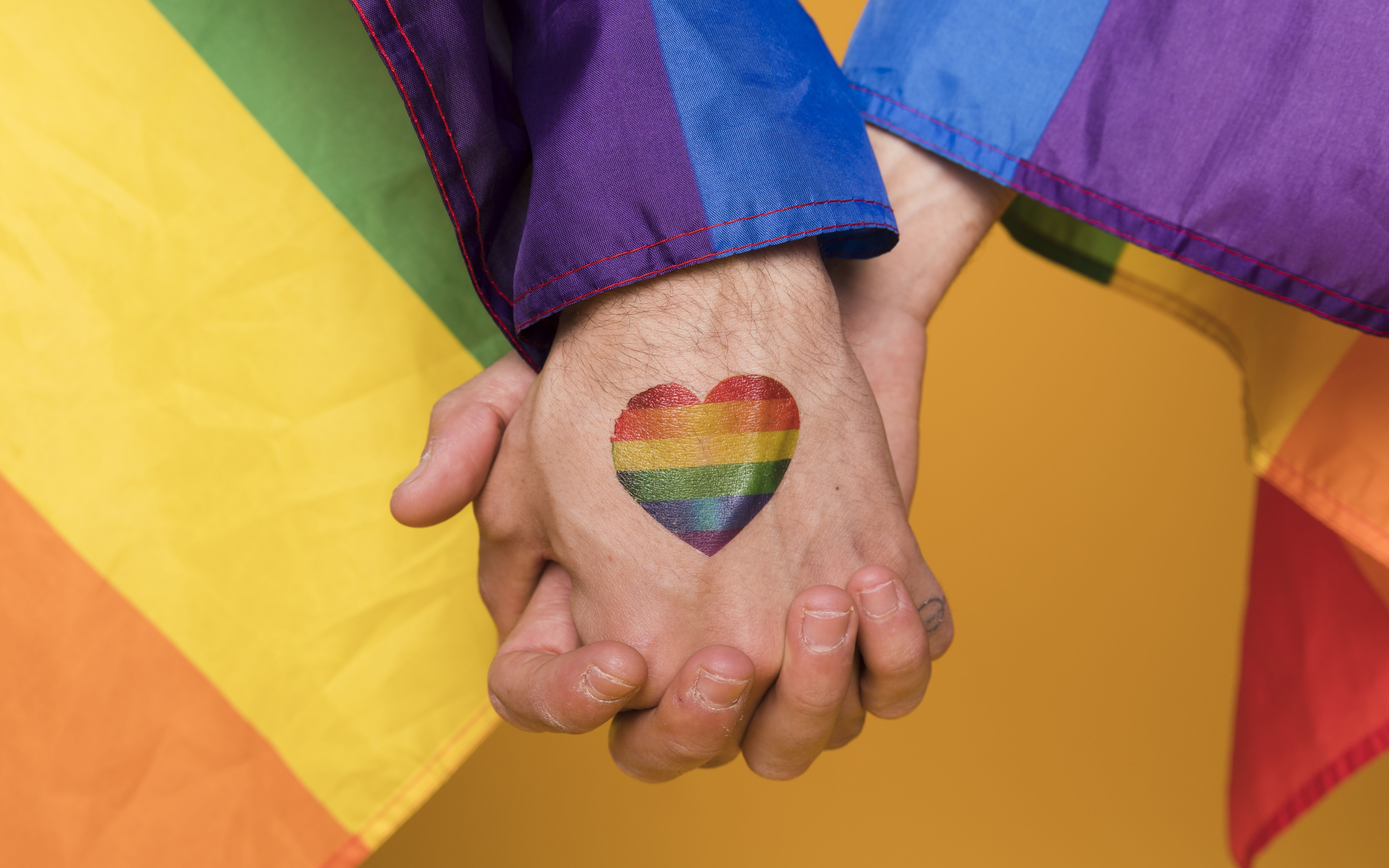 Gay married couple flee russia after receiving death threats