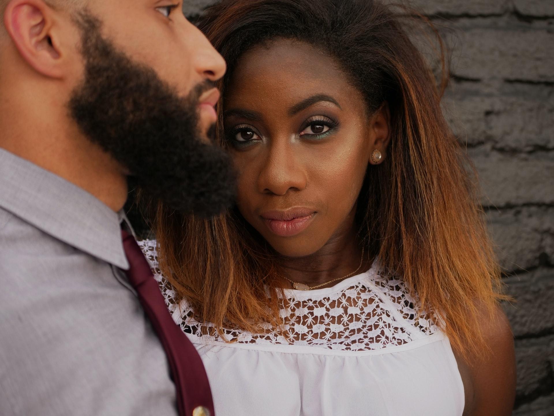 black woman wearing white shirt beside man