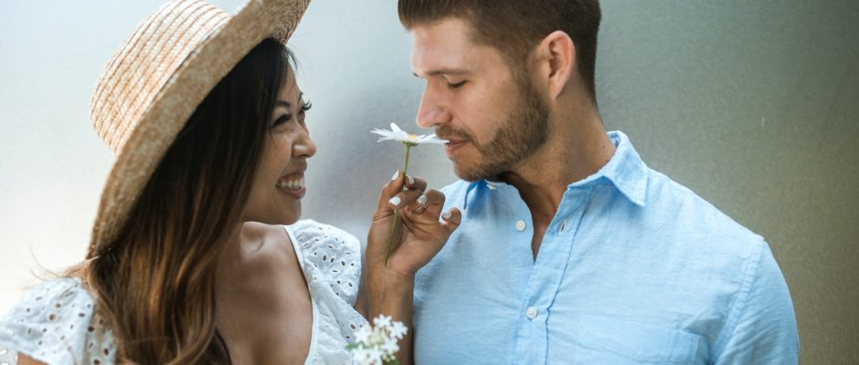 asian woman showing flowers to a western man
