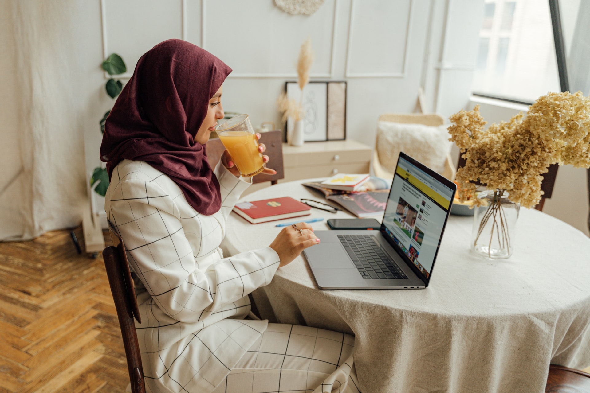 Woman in Hijab using a Laptop for online dating
