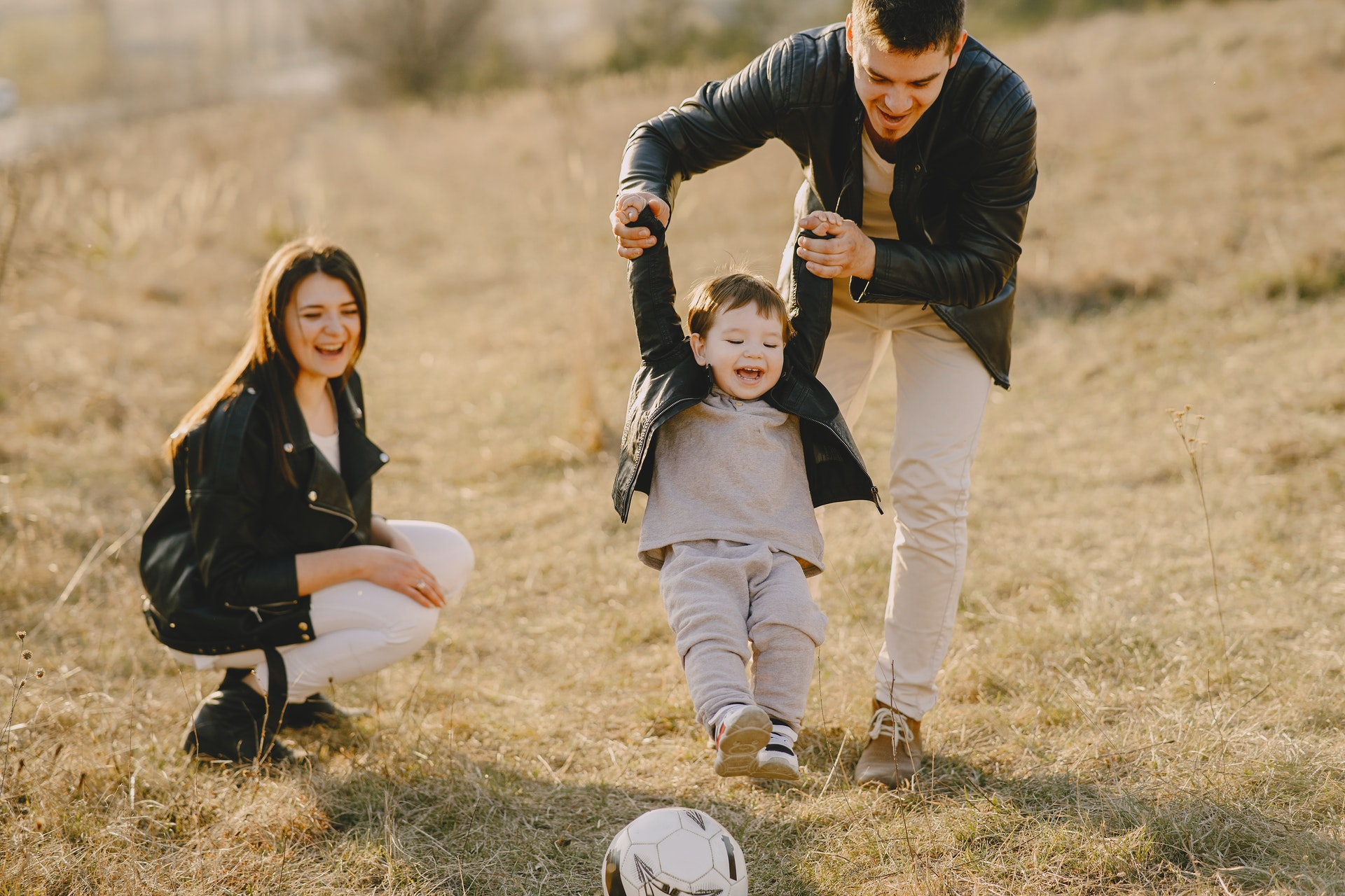 a family has fun with soccer ball