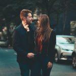 Romantic modern young couple bonding on street