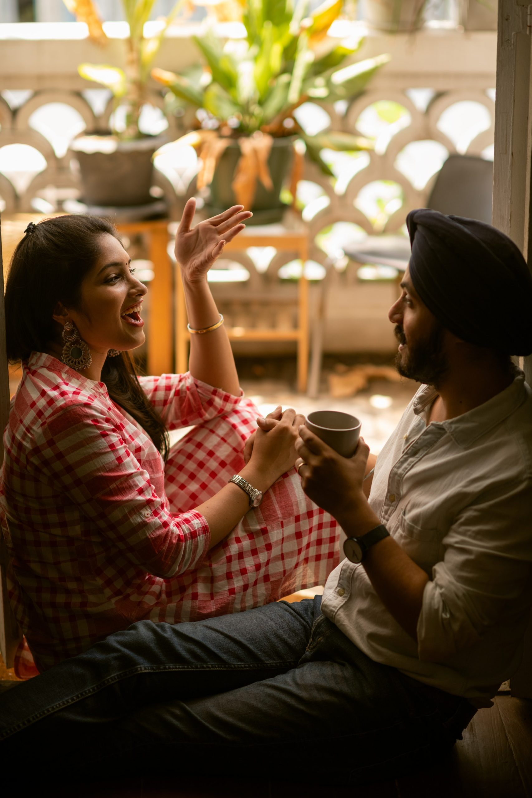 young Indian couple talking happily to each other