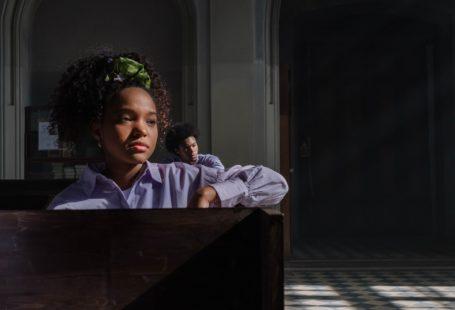 a woman sitting inside a church