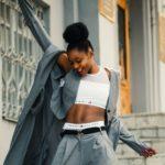 a happy black woman in gray blazer