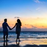 divorced single man and woman holding hand by the beach