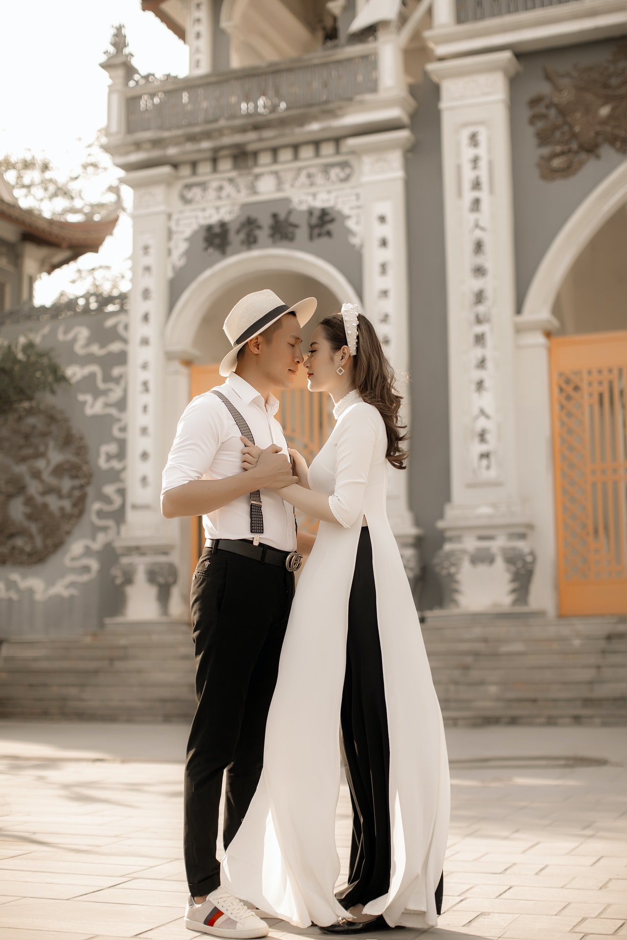 a man dating a Buddhist woman who is wearing Ao Dai