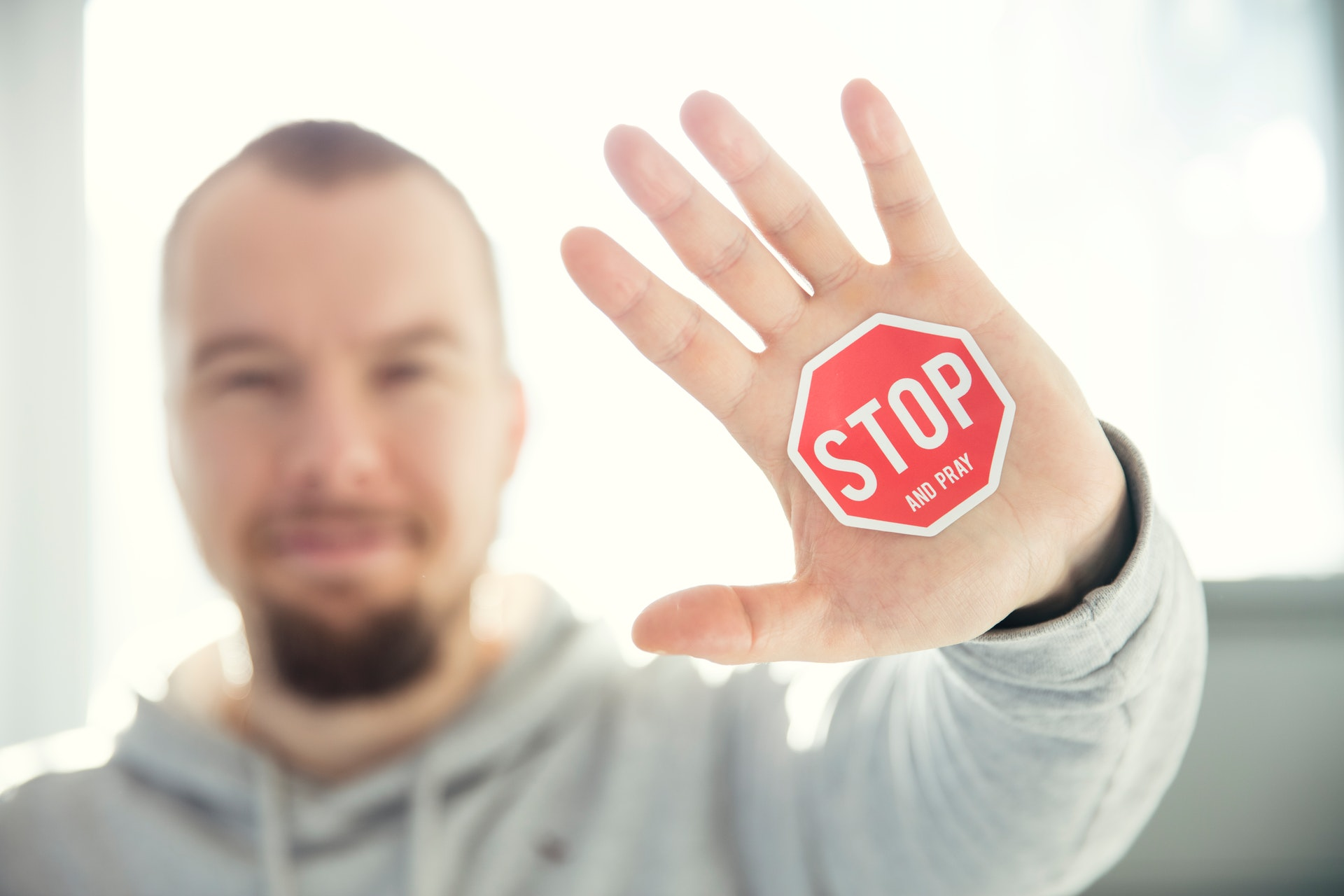 photo of a person's hand with stop sign