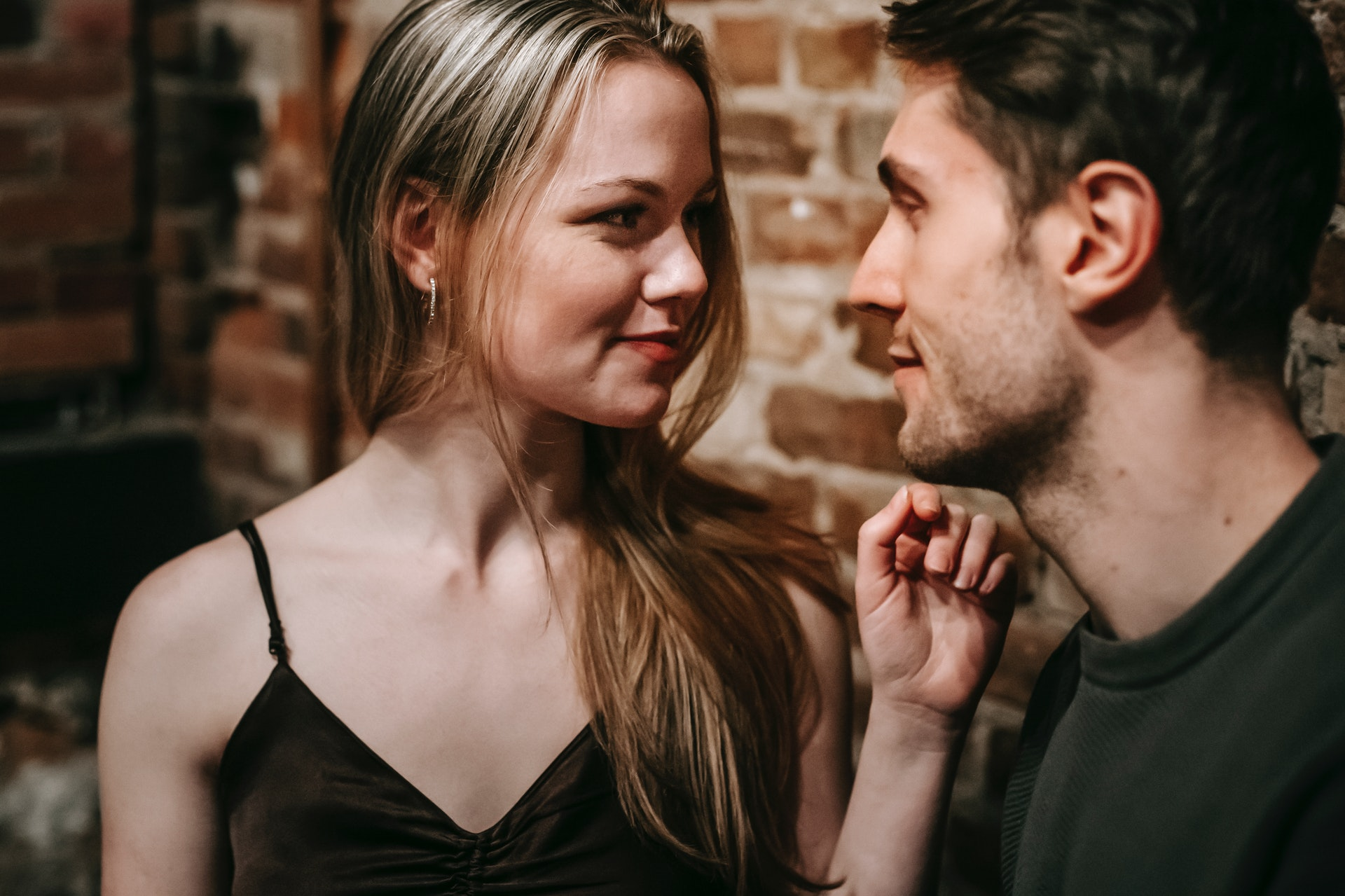 a man and a woman look passionately at each other