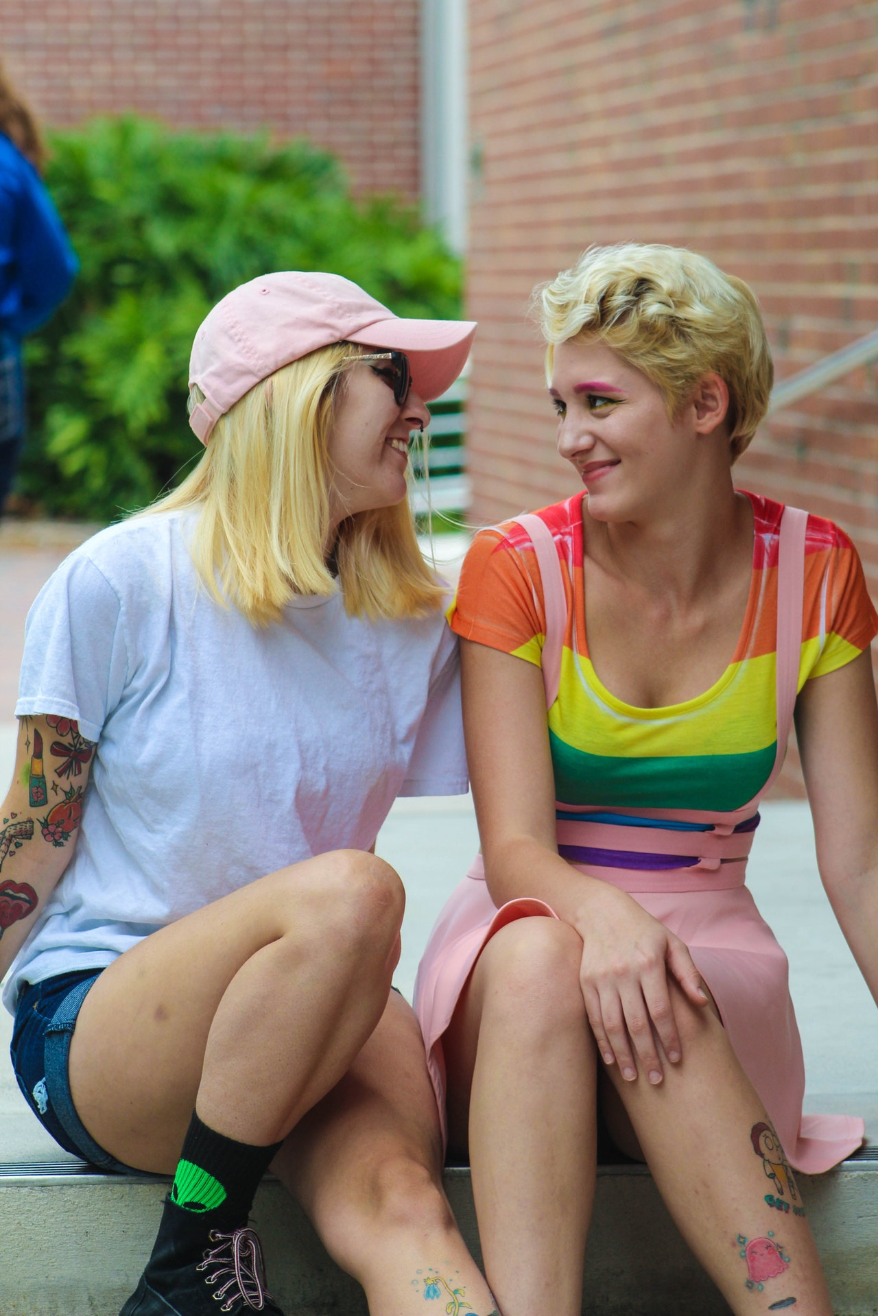 2 lesbian women siting close to each other