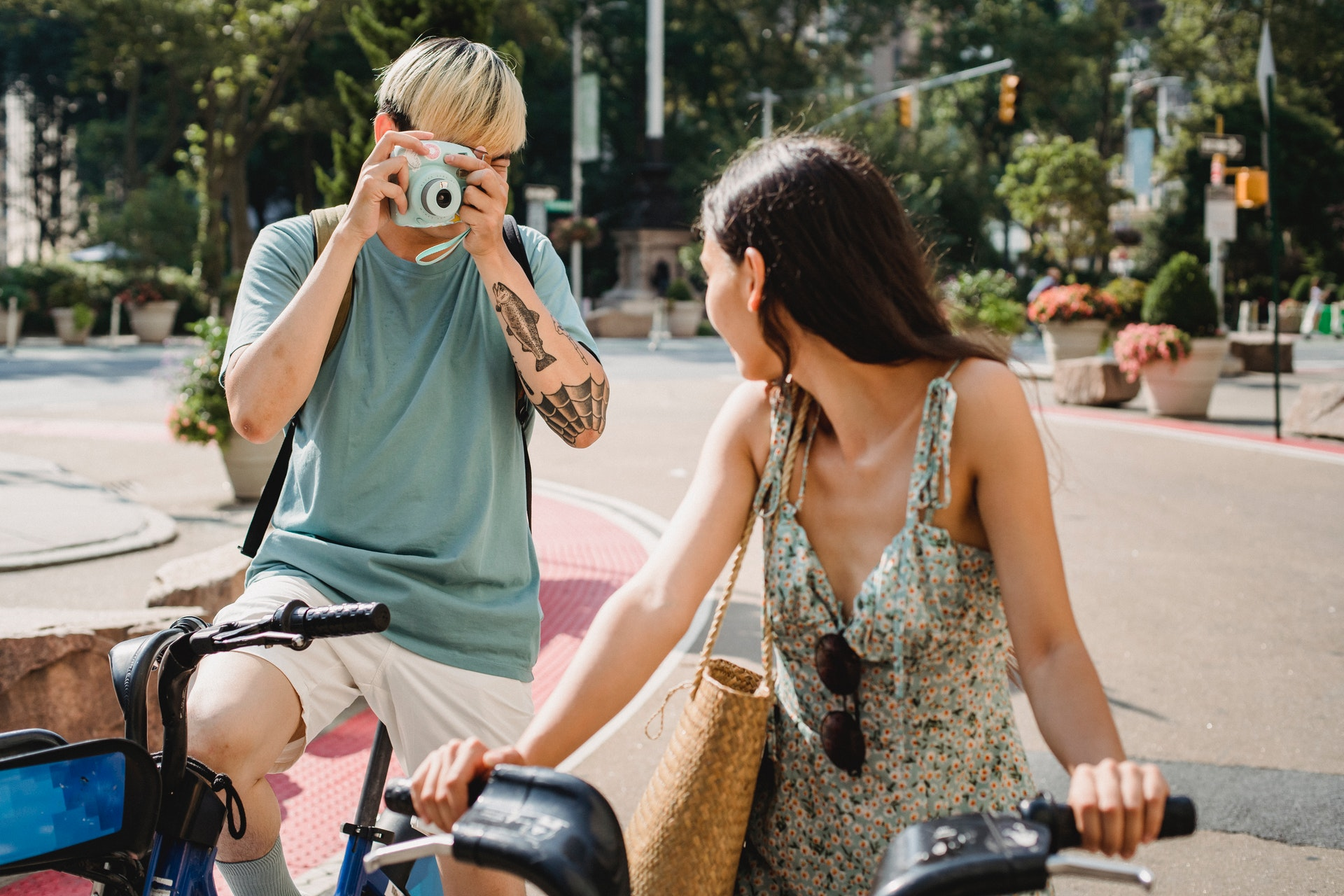 a man taking photo of a woman on bike