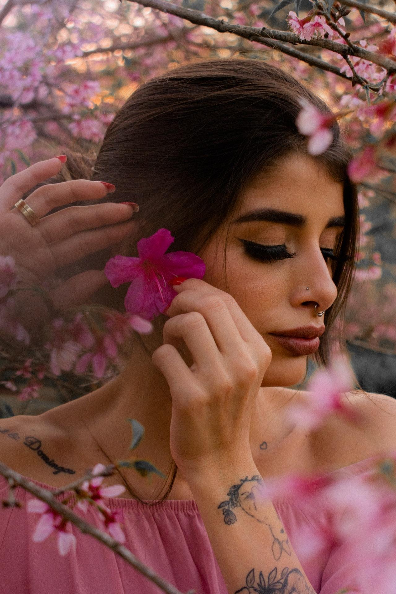 a focus photo of a Latina wearing shoulder-off pink shirt