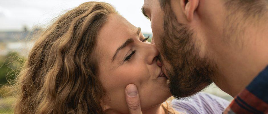 a man kissing a woman as it's how men show love