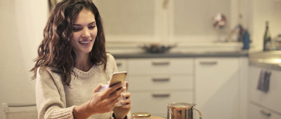 a woman is texting to keep a conversation going