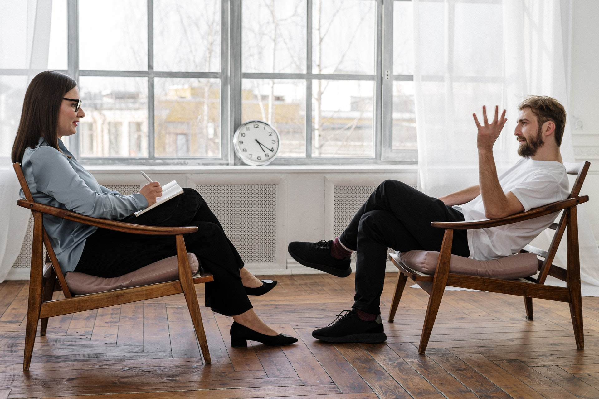 woman is counseling for a man after he ends a long-term relationship