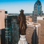 bronze statue in top of a building in Philadelphia city,