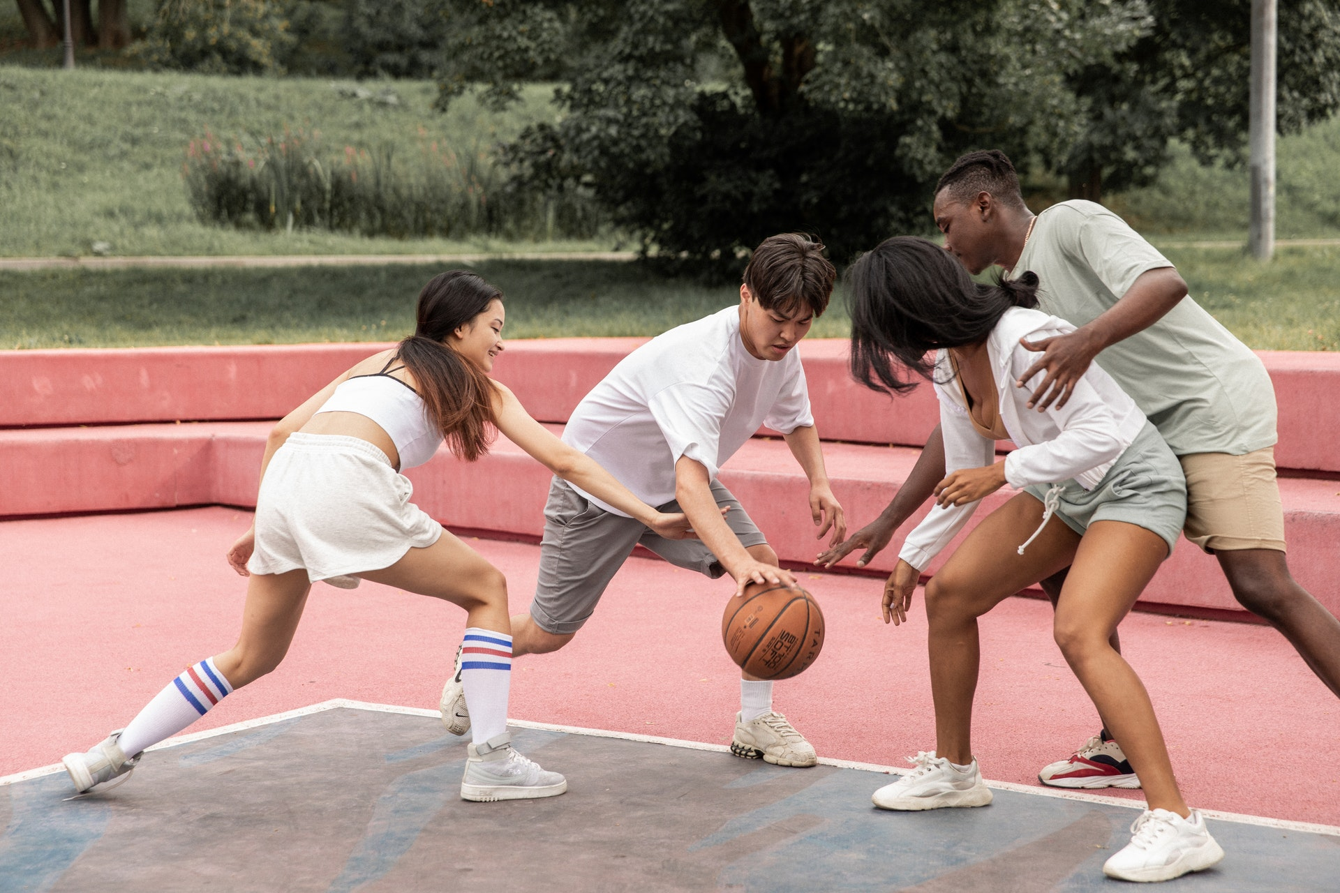 a diverse young people play sport