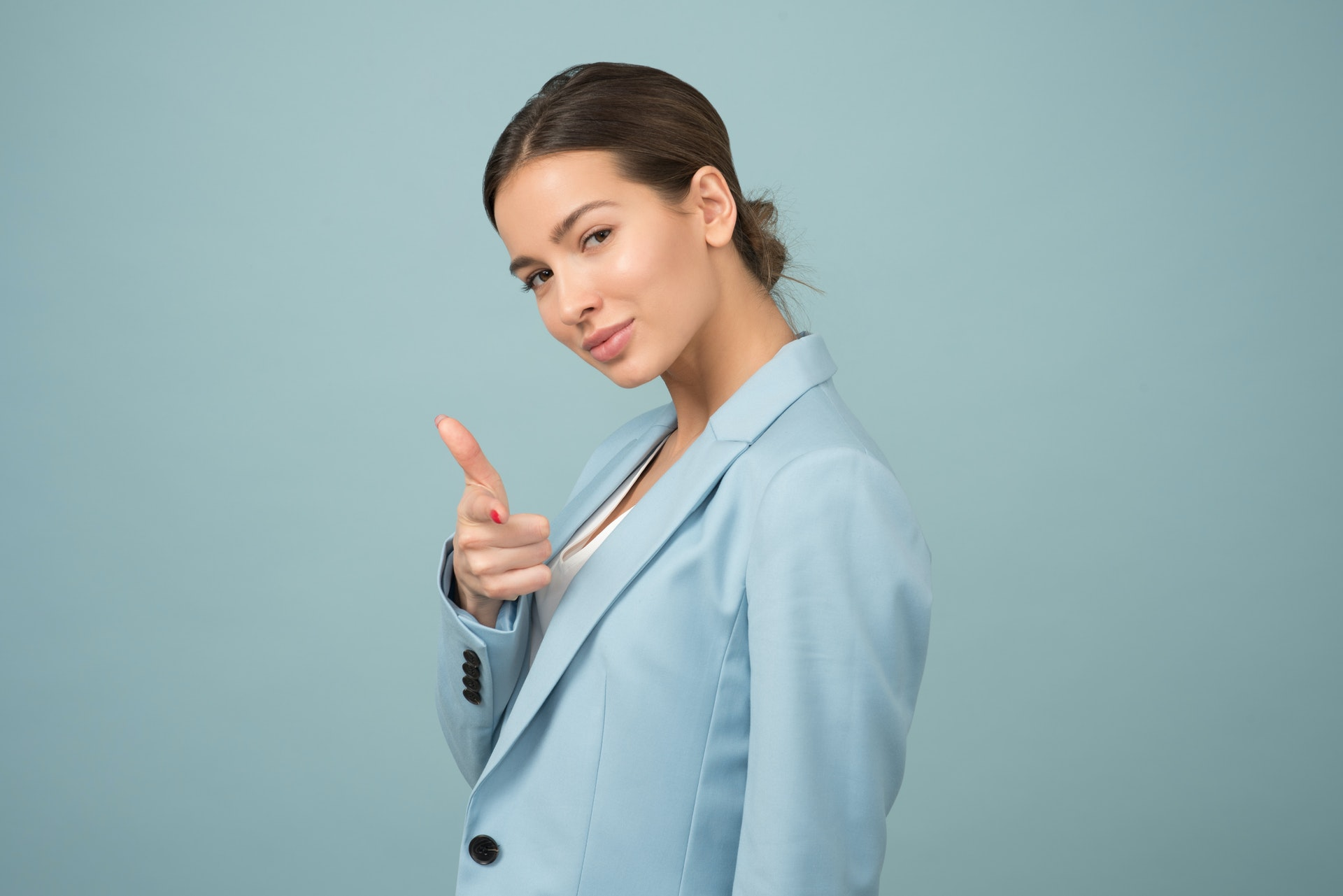 a confident woman wearing blue jacket