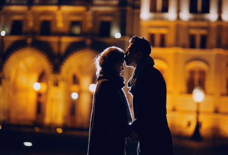 Couple kissing at night, dating in the city